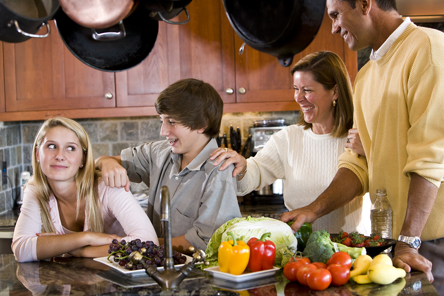 happy family with teenagers smiling in kitchen, Kitchen