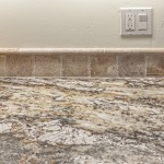 "Netuno Bordeaux granite with 4"" Crema Viaho back-splash"