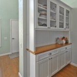 Custom hutch with glass doors, wood top and Cherry clear finish