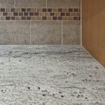 "Tumbled Bianco 6""x6"" tile and Sangria glass tile backsplash"